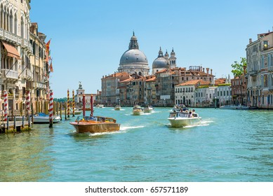 Venice, Italy - May 18, 2017: Water taxis are sailing along the Grand Canal in Venice. Motorboats are the main transport of Venice. Romantic water trip in Venice.