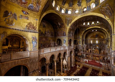 Venice, Italy - May 21, 2017: Luxury interior of St Mark`s Basilica (San Marco) in Venice. It is one of the main tourist attractions of Venice. Inside the famous ancient temple of Venice.