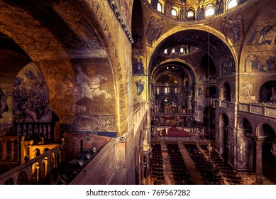 Venice, Italy - May 21, 2017: Interior of the Saint Mark`s Basilica (San Marco). Ancient decoration of Saint Mark`s Basilica. Golden mosaic inside the Saint Mark`s Basilica.
