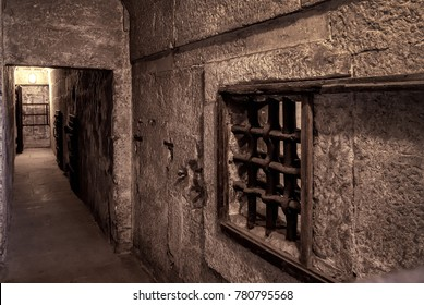 Venice, Italy - May 21, 2017: Old prison at the Doge`s Palace (Palazzo Ducale) in Venice. Doge`s Palace is one of the main tourist attractions of Venice. Historical dungeon with prison bars.