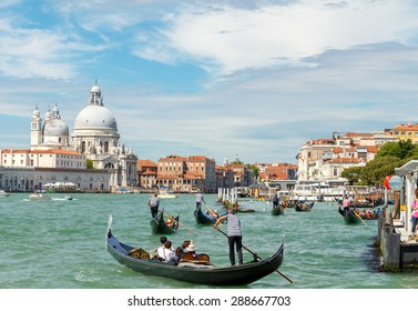 Venice, Italy - May 24, 2015: Gondolas with tourists on the Grand Canal. Gondola ride is one of the most popular tourist attractions in Venice.