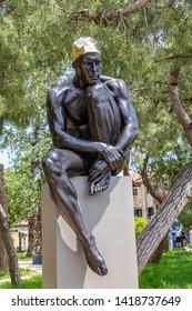 Venice Italy - May 25, 2019:  Biennale Arte 2019 Sculpture of a male swimmer by Carole Feuerman in Giardini della Marinaressa