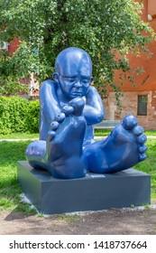 Venice Italy - May 25, 2019:  Biennale Arte 2019 Sculpture Babyfoot  by Idan Zareski in Giardini della Marinaressa