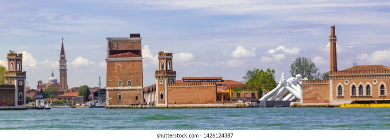 Venice Italy - May 25, 2019: Biennale Arte 2019 Sculpture of giant white hands called Building bridges by Lorenzo Quin at the entrance of the Arsenale