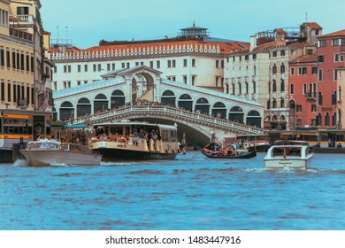 Venice, Italy - May 25, 2019: view of grand canal full of boats and gandolas rialto bridge on background. summer time
