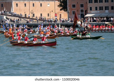 VENICE, ITALY - MAY 28 : Boats full of people, musicians and rowers arrive at the historic feast of the Feast of the Sensa in Venice where the city marries the sea in Venice, Italy on May 28, 2017.