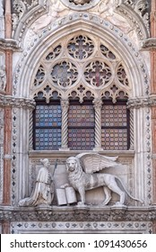 VENICE, ITALY - MAY 28 : Detail of the Porta della Carta entrance to the Doge's Palace in Venice, Italy, depicting Doge Francesco Foscari kneeling before the Lion of St. Mark, on May 28, 2017.