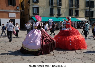 VENICE, ITALY - MAY 28 : Tourists in Venice on the Grand Canal are welcomed by costumed ladies in Venice, Italy on May 28, 2017.