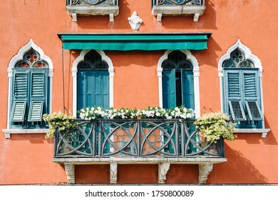 Venice, Italy - May 30, 2020: Terrace of a Venetian palace decorated with flowers along the Giudecca canal
