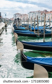 Venice, Italy - May 30, 2020: Gondolas moored on the Grand Canal during the Covid 19 pandemic - Coronavirus