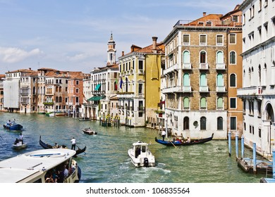 VENICE, ITALY - MAY 4: Grand Canal forms a major water-traffic corridors in Venice. On the channel moving water buses, private water taxis and many gondola with tourists. Venice, Italy, May 4, 2012