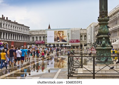 VENICE, ITALY - MAY 4: Piazza San Marco (St Mark's Square) is the principal public square of Venice. It's always crowded square in front of San Marco Basilica. After a tide. Venice, Italy, May 4, 2012
