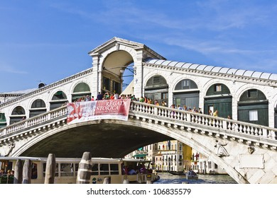VENICE, ITALY - MAY 4: Rialto Bridge is oldest bridge across Grand Canal in Venice. Present stone bridge, designed by Antonio da Ponte, a single span was completed in 1591. Venice, Italy, May 4, 2012