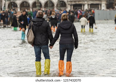 VENICE, ITALY - NOVEMBER 01, 2018: People walking in Piazza San Marco in Venice during a flood.