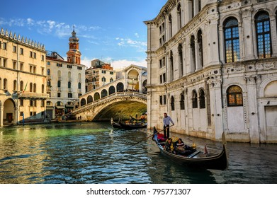 Venice, Italy -  November 06: Gondolas riding on the Grand Canal under Rialto bridge is one of main tourist attractions of Venice. Venice, Italy, on November 06, 2012