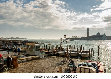 Venice, Italy - November 12, 2016: View on San Giorgio Maggiore island in Venice with a landing stage in front