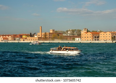 Venice, Italy - November 12, 2016: Water taxi commuting in the canals of Venice, motorboats are the common way of traveling