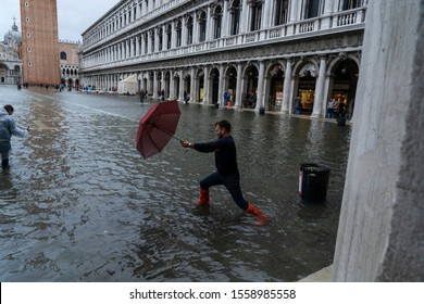 VENICE, ITALY - November 12, 2019: St. Marks Square (Piazza San Marco) during flood (acqua alta) in Venice, Italy. Venice high water.