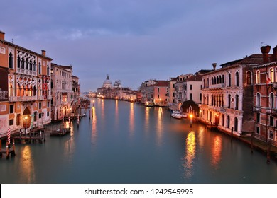 """Venice (Italy): November 24, 2018: From the Ponte dell'Accademia you can enjoy one of the beautiful views of the city, in the distance, you can see the Church of """"Santa Maria della Salute""""."""