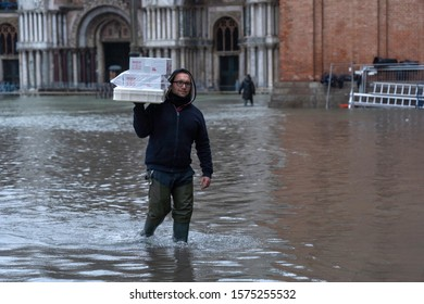 VENICE, ITALY - November 24, 2019: St. Marks Square (Piazza San Marco) during flood (acqua alta) in Venice, Italy. Venice high water. Natural disaster