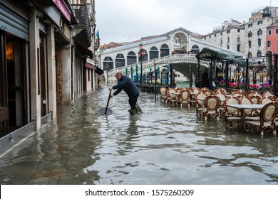 VENICE, ITALY - November 24, 2019: flood (acqua alta) in Venice, Italy. Venice high water. Tourists in Venice during a flood. Natural disaster. drama during the flood