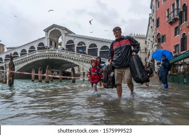 VENICE, ITALY - November 24, 2019: Rialto bridge during flood (acqua alta) in Venice, Italy. Venice high water. Natural disaster