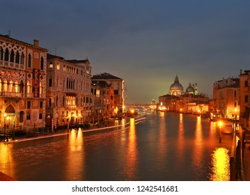 """Venice (Italy): November 24th, 2018, From the Ponte dell'Accademia you can enjoy one of the most beautiful views of the city with, in the distance, the Church of """"Santa Maria della Salute""""."""