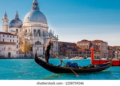 Venice, ITALY - November 29, 2018: Water traffic of gondolas in Grand Canal, sunny day.