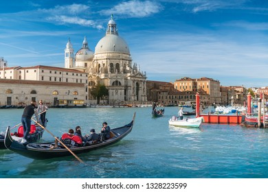 Venice, Italy Oct31, 2018, , Europe, historic famous travel city, tourists ride the Gondola boat, Church of San Giorgio Maggiore in background near San Marco square on beautiful sunny day.