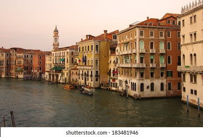 VENICE, Italy - OCTOBER 06: Grand canal at sunset on October 06, 2011 Venice, Italy. One of beautiful medieval venetian canals, attracting thousands tourists from all over the world