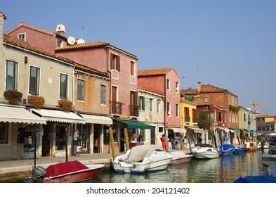 VENICE, Italy - OCTOBER 06: Quay of Murano island on October 06, 2011 Venice, Italy. One of beautiful medieval venetian canals on Murano island in Venetian Lagoon