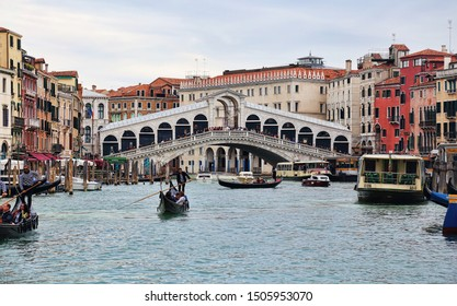 Venice, Italy - October 1, 2018: Gondolas with tourists and the Rialto bridge on the Grand Canal in Venice, Italy on October 1, 2918