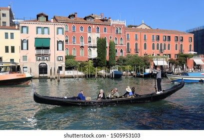 Venice, Italy - October 1, 2018: Gondola with tourists and historical buildings on the Grand Canal in Venice, Italy on October 1, 2018
