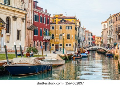 Venice, Italy - October, 2019: Traditional canal street with gondolas and boats in Venice, Italy.