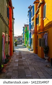 VENICE, ITALY - OCTOBER 22, 2018, colorful houses on the island of Burano in Venice with walking tourists. The concept of travel and tourism.