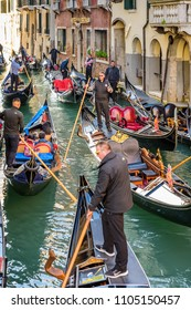 VENICE, ITALY - OCTOBER 24, 2017: A small canal in Venice packed with Gondolas.