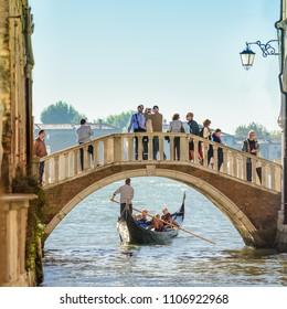 VENICE, ITALY - OCTOBER 24, 2017: A gondola under a bridge close to the Baglioni Hotel Luna in Venice, Italy.