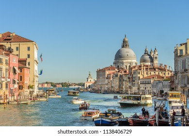 VENICE, ITALY - OCTOBER 24, 2018: View of the Grand Canal with the Santa Maria della Salute church in the background.