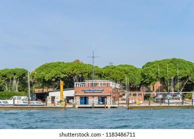 VENICE, ITALY - OCTOBER 25, 2018:  School of the navy flotilla Francesco Morosini. View from the Venice lagoon.