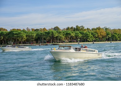 VENICE, ITALY - OCTOBER 25, 2018:  Water taxi on the grand canal speeding towards Venice.