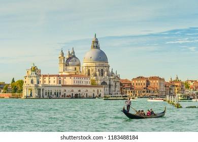 VENICE, ITALY - OCTOBER 25, 2018: Basilica di Santa Maria della Salute and the grand canal in Venice, Italy.