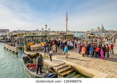 VENICE, ITALY - OCTOBER 25, 2018:  Passengers at the busy Gondole Danieli and ACTV San Zaccaria vaporetti station.