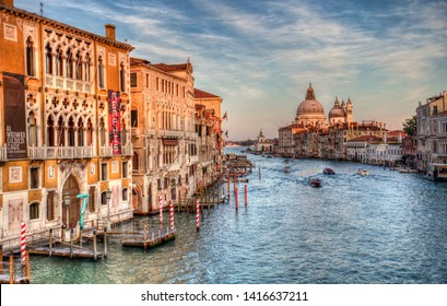 Venice, Italy - October 3, 2018: Boats on the Grand Canal and the Santa Maria della Salute church in Venice, Italy on October 3, 2018