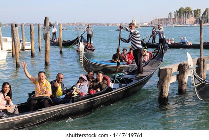 Venice, Italy - October 3 2018: Gondolas with tourists and the island and church of San Giorgio Maggiore in Venice, Italy on October 3, 2018