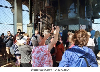 Venice, Italy - October 3, 2018: Tourists in the clock tower of San Marco with a large bell in Venice, Italy on October 3, 2018