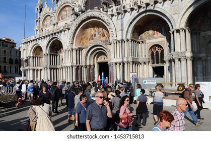 Venice, Italy - October 3, 2018: Tourists on San Marco square and the San Marco basilica in Venice, Italy on October 3, 2918