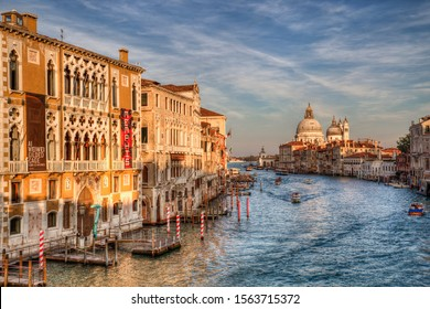 Venice, Italy - October 3, 2018: Boats on the Grand Canal and Santa Maria della Salute church in Venice, Italy on October 3, 2018
