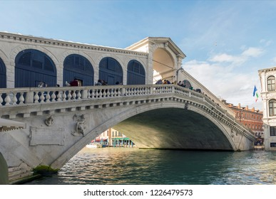 VENICE, ITALY- OCTOBER 30, 2018: The Rialto Bridge is a central area of Venice, Italy, in the sestiere of San Polo