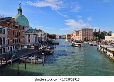Venice, Italy - October 4, 2018: Historical buildings along the Grand Canal opposite the railway station in Venice, Italy on October 4, 2018