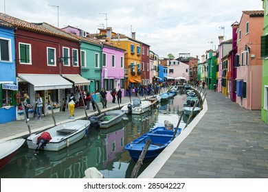 VENICE, ITALY, on APRIL 30, 2015. Burano island, typical street canal and multi-colored houses of locals. Burano the island - one of attractive tourist objects in the Venetian lagoon
